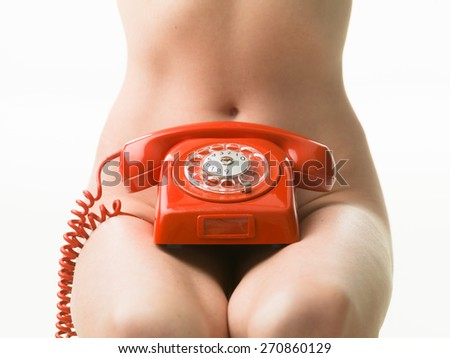closeup of sexy naked woman with red phone - stock photo