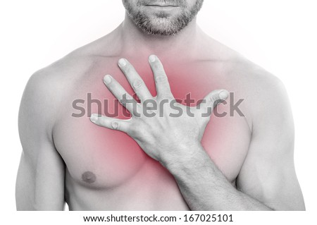 Closeup of shirtless bearded muscular Caucasian man with chest pain pressing hand on chest on white background - stock photo