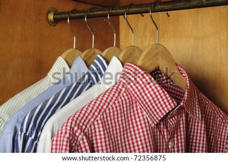 closeup of  shirts hanging - stock photo