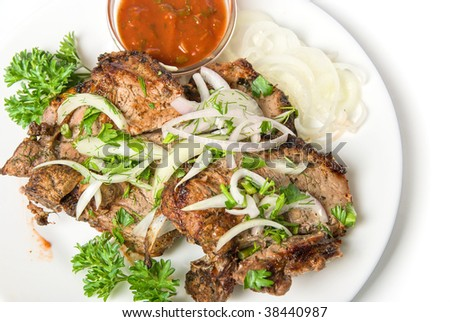 Closeup of shish kebab isolated on white background