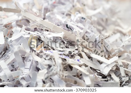 Closeup of shredded paper documents - stock photo