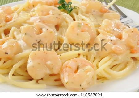 Closeup of shrimp scampi on spaghetti noodles - stock photo