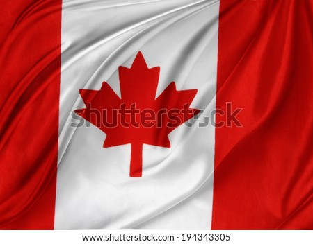 Closeup of silky Canadian flag - stock photo