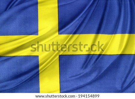 Closeup of silky Swedish flag - stock photo