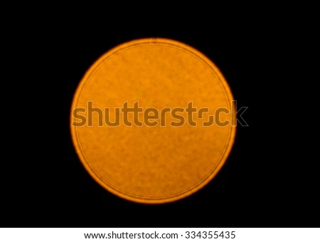 Closeup of Single golden bokeh on black background - stock photo