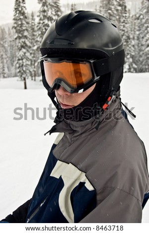 Closeup of Skier or Snowboarder with Helmet - stock photo