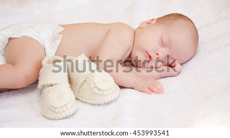 Closeup of sleeping baby - stock photo
