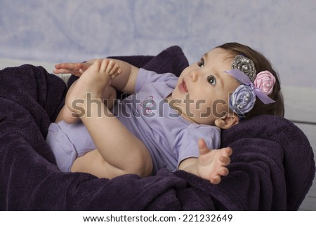 Closeup of Smiling Baby Girl in basket - stock photo
