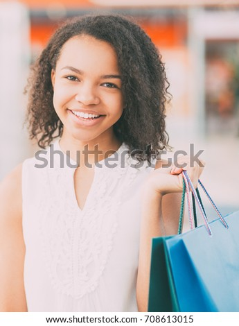 Closeup of Smiling Black Girl With Shopping Bags