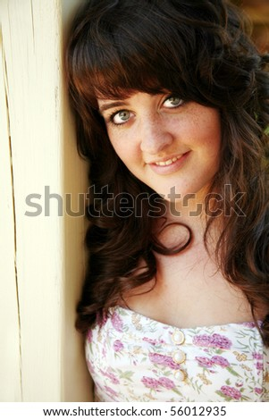 closeup of smiling brunette teen girl outside - stock photo