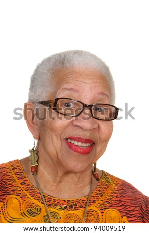closeup of smiling elderly African American Woman wearing black rimmed glasses isolated on white - stock photo