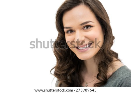 Closeup of smiling girl looking at camera isolated on white background