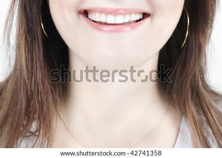 Closeup of smiling woman mouth with great teeth with selective focus - stock photo