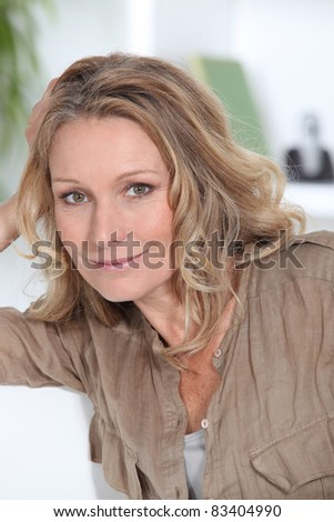 Closeup of smiling woman with long hair - stock photo