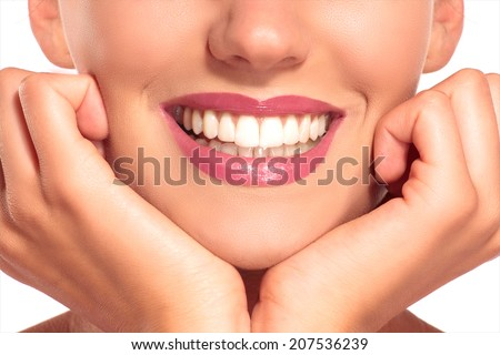 Closeup of smiling woman with perfect white teeth on white - stock photo