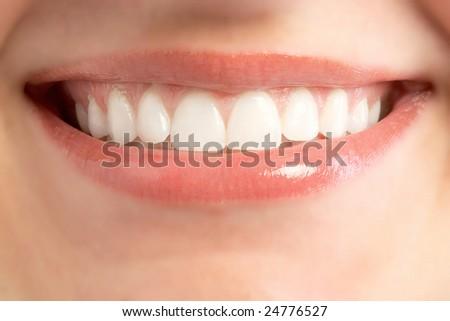 Closeup of smiling young woman mouth teeth - stock photo