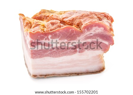 Closeup of Smoked Bacon Slab Cut over white background, Shallow Focus, Horizontal shot