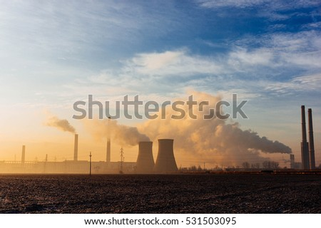 Closeup of smokestacks with pollution in a sunny day
