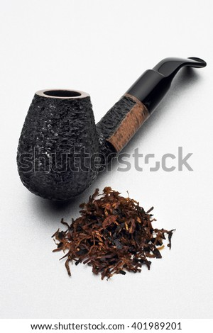 Closeup of smoking pipe with tobacco isolated on white background - stock photo