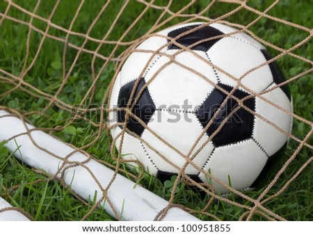 closeup of soccer ball in goal - stock photo
