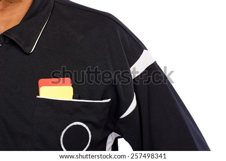 Closeup of soccer referee with red and yellow card in pocket - stock photo
