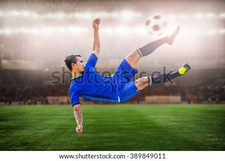 closeup of soccer striker shooting ball in the stadium