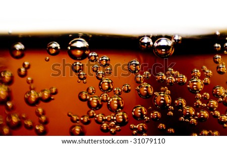 Closeup of soft drink with bubbles in glass - stock photo