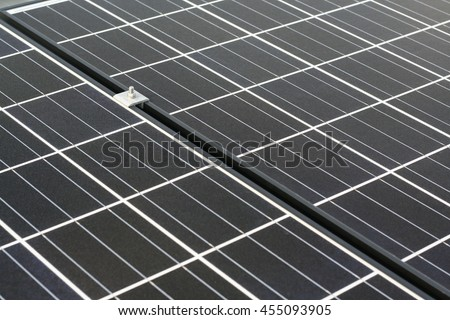 Closeup of solar panel and clamp  - stock photo