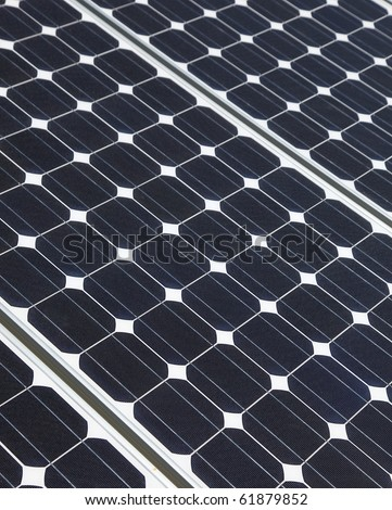 Closeup of solar panel cells mounted on roof top. Solar energy is becoming an important part of the energy mix. - stock photo
