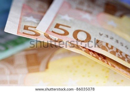 closeup of some 50 and 100 euro bills - stock photo