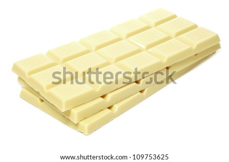 closeup of some bars of white chocolate on a white background - stock photo
