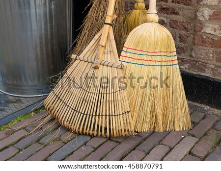 closeup of some brooms for various household cleaning