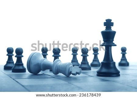 Closeup of some chess figures on white background