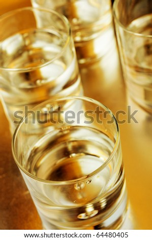 closeup of some glasses with mixed drinks in a club - stock photo