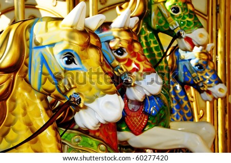 closeup of some horses of a vintage carousel - stock photo