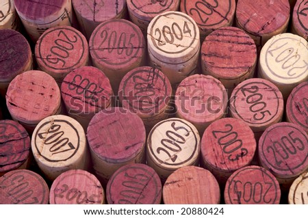 Closeup of some red wine corks - stock photo
