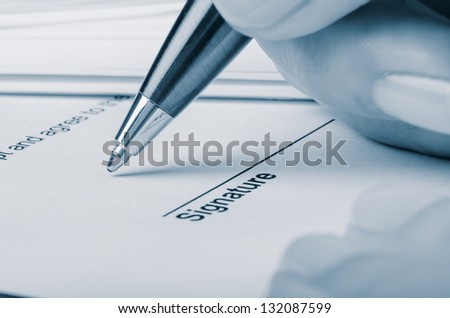 Closeup of somebody signing contract - stock photo