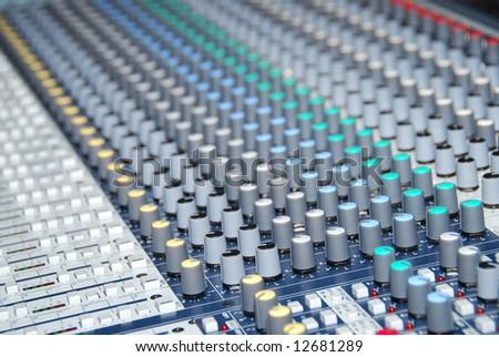 closeup of sound control mixer - stock photo