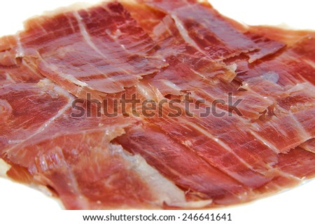 Closeup of spanish serrano ham on white background. Jabugo ham. Spanish tapa - stock photo