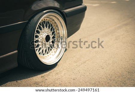 Closeup of sport car rims with copy space for text. Vintage filter. - stock photo