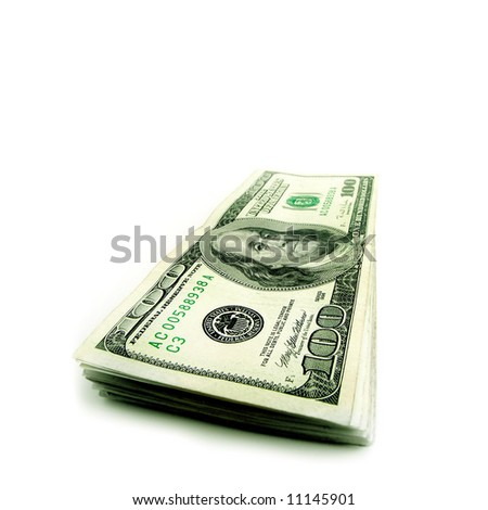Closeup of stack of hundred dollar bills isolated on white background