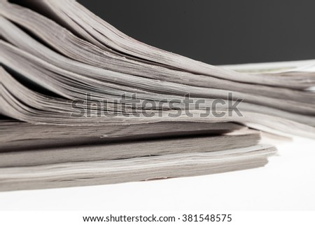 Closeup of stack of newspapers. Assortment of folded newspapers isolated on white. Breaking news, journalism, power of the media, newspaper and magazine ads and subscription concept.