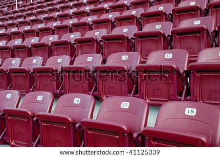 closeup of stadium seats in a large stadium - stock photo