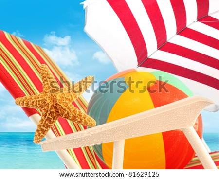 Closeup of starfish on sun chair at the beach - stock photo