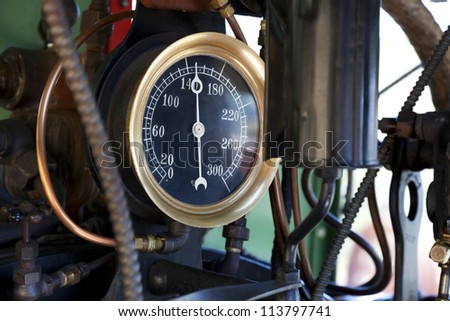 Closeup of steam pressure guage in cab of working vintage steam train locomotive. - stock photo