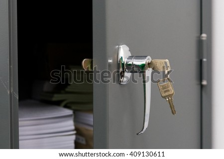 Closeup of  Steel filing cabinet with the key - stock photo
