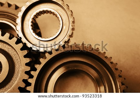 Closeup of steel gears meshing together - stock photo