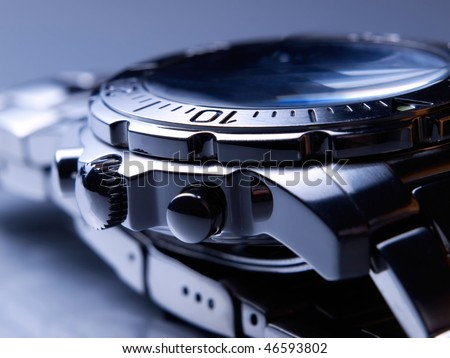 Closeup of steel wrist watch.