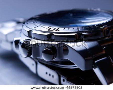 Closeup of steel wrist watch. - stock photo