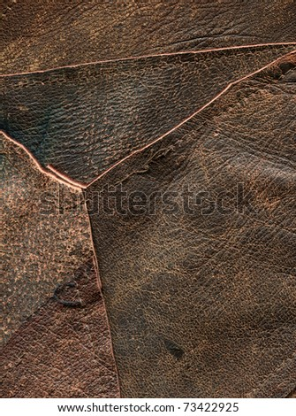 closeup of stitched together pieces of leather - stock photo